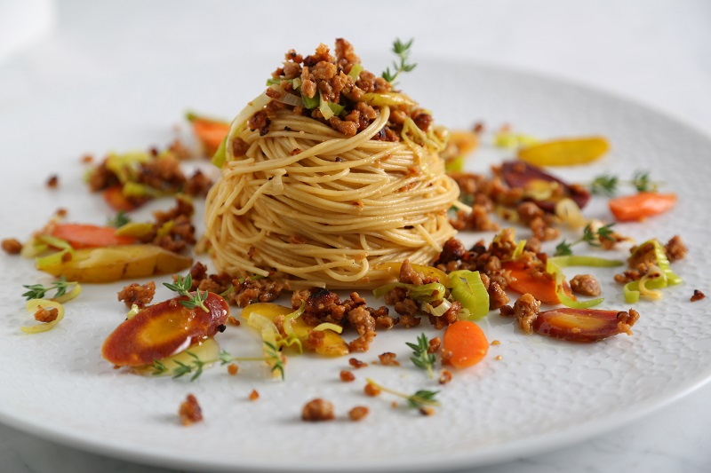 Get all the ground beef flavor without any of the meat in this angel hair vegetarian pasta recipe with plant-based beef