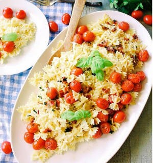 Farfalle pasta salad with cherry tomatoes and basil