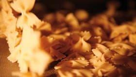 pouring farfalle pasta