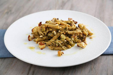 Barilla Protein+™ Penne Recipe with Pesto, Charred Cauliflower, Pine Nuts and Crispy Bacon
