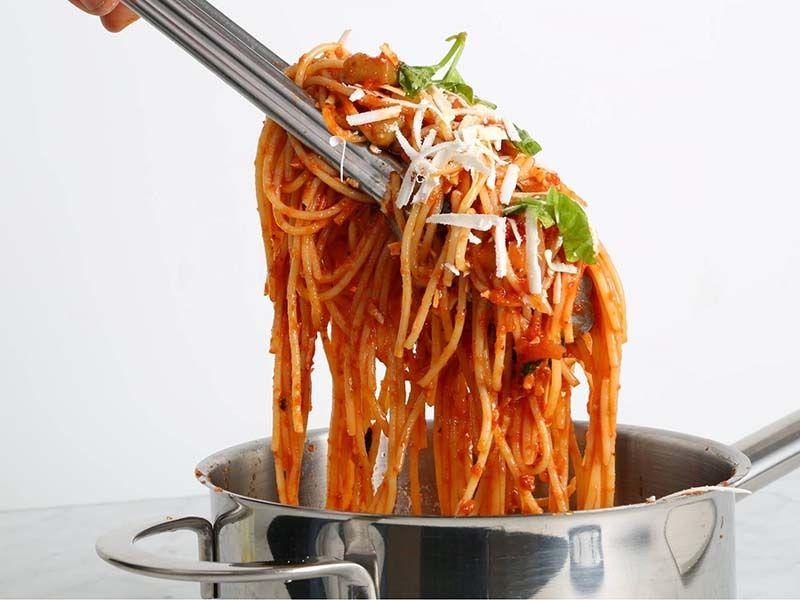 Pasta alla Norma Spaghetti Recipe with fried Eggplants, Ricotta, and Basil