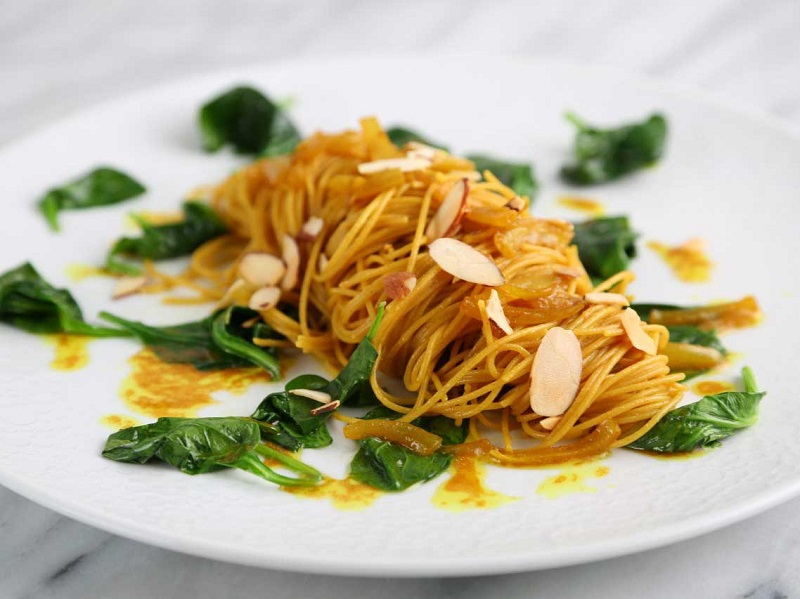 Whole-Grain Angel Hair Pasta with Turmeric Onions, Spinach & Almonds