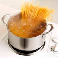spaghetti in a pot of boiling water