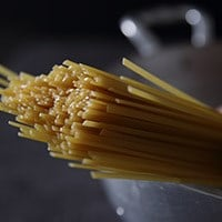 Bunch of spaghetti in a pot of boiling water