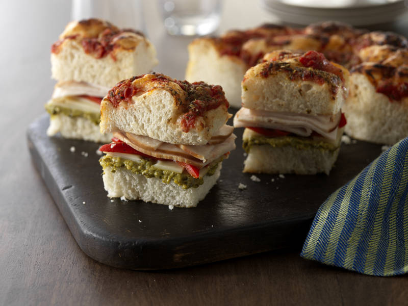 Creamy Ricotta & Basil Pesto foccacia sandwiches with turkey and roasted red peppers