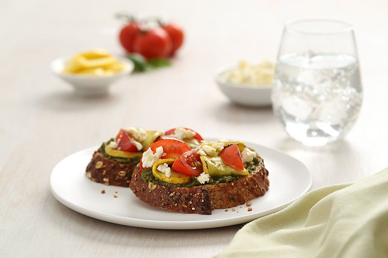 Barilla Traditional Basil Pesto crostini with squash, tomatoes and feta cheese