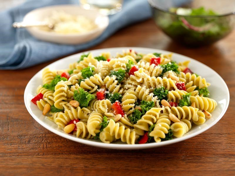 Barilla Veggie Rotini pasta with kale and roasted peppers and pine nuts