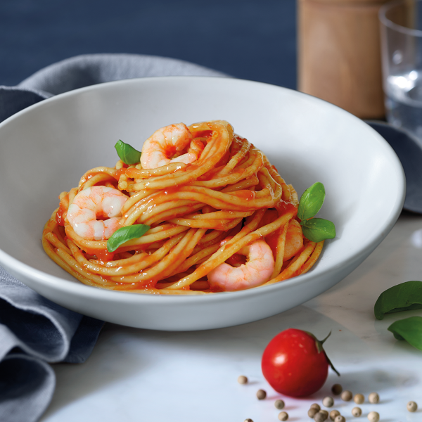 Spaghetti with shrimps tomatoes and basil