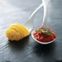 pasta and sauce on plastic utensils