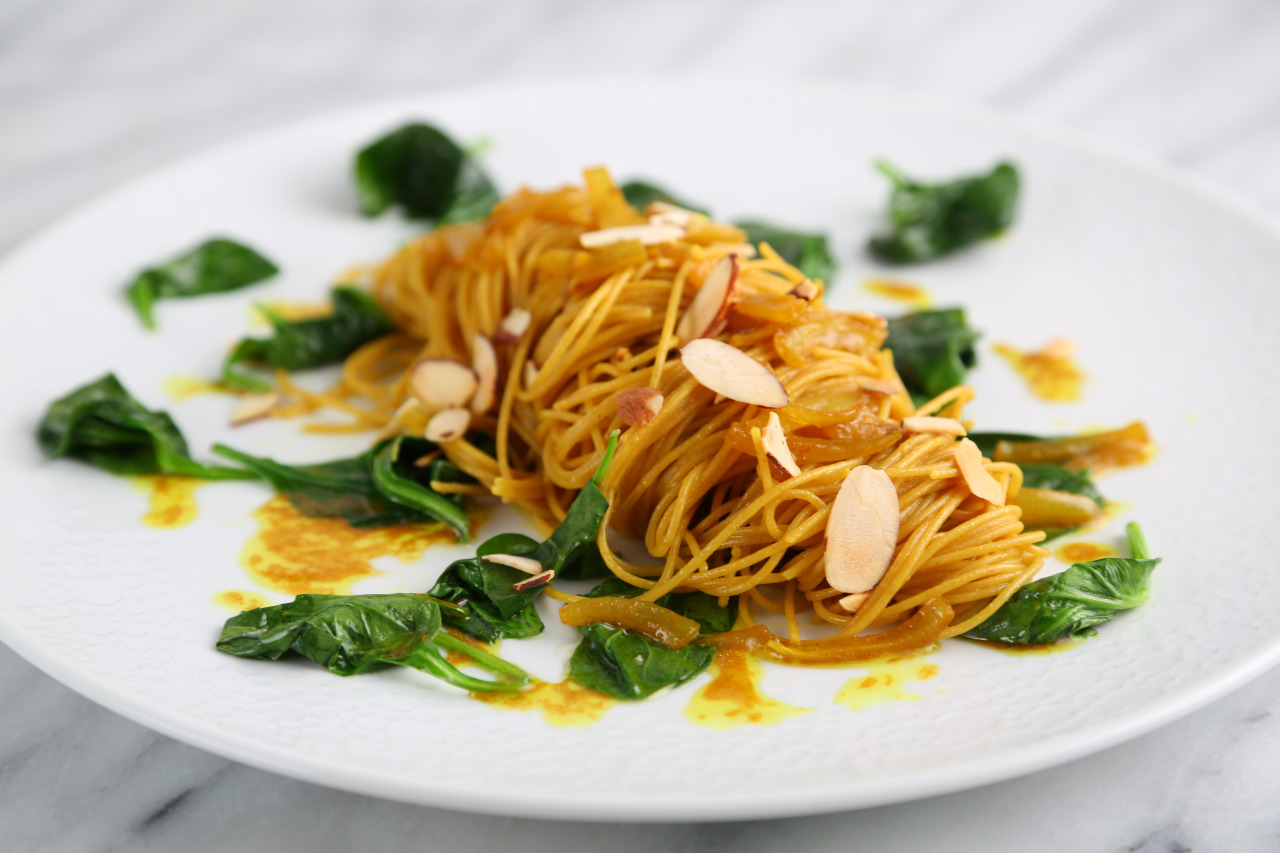 Whole-Grain Angel Hair with Turmeric-Braised Vidalia Onion, Baby Spinach and Toasted Shaved Almonds