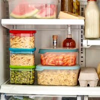 dry pasta in storage containers on shelves